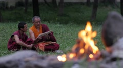 Buddhist teacher and student with fire,Rewalsar,Himachal Pradesh,India Stock Footage