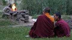 Buddhist teacher and student with fire at lake,Rewalsar,Himachal Pradesh,India Stock Footage