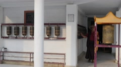 Pilgrim spins prayer wheels at monastary,Rewalsar,Himachal Pradesh,India - stock footage