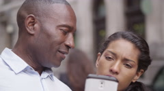 4k, close-up of attractive, couple using smartphone for directions in city stree Stock Footage
