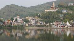 Rewalsar lake with giant statue,Rewalsar,Himachal Pradesh,India Stock Footage