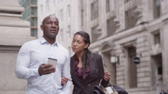 4k, handsome couple walking through city street using smartphone for directions - stock footage