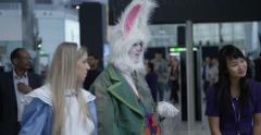Actors playing in Heathrow airport to celebrate 150 years of Alice in Wonderland - stock footage