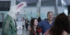Stage actors portraying 'Alice in Wonderland' at Heathrow Airport - stock footage