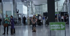 Interior of Heathrow Airport just past security in London England Stock Footage
