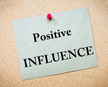 Positive Influence Message written on paper note Stock Photos
