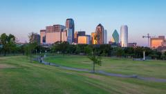 4k Dallas Skyline sunrise Time-lapse and park joggers w/ dogs Stock Footage