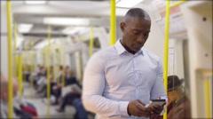 4k, handsome man on smartphone on subway train.  Stock Footage