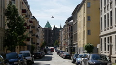 Street in Oslo with the Frogner Church in the background Stock Footage