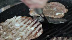 Man Flipping Beef Burgers Stock Footage