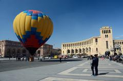 People launching colorful hot air balloon on Republic square ,Erevan - stock photo