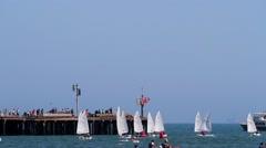 Small yachts racing at the Santa Barbara pier, California, USA Stock Footage