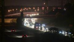 Traffic jam on freeway at night Stock Footage