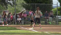 Rural community softball game hit and run 4K Stock Footage