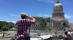 Tourist taking photos of the famous Capitol in Havana, Cuba Stock Footage