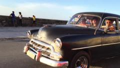 Old Chevy in Malecon avenue in Havana, Cuba Stock Footage