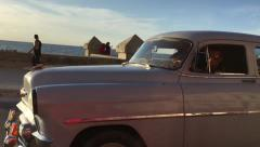 Stock Video Footage of Old Chevy in Malecon avenue in Havana, Cuba