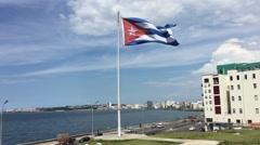 The flag of Cuba waving in the wind in Havana, Cuba Stock Footage
