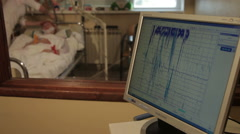 Monitoring functions of brain. Neurology. Eeg. Patient lying in hospital room. Stock Footage