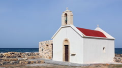 White red small church on a seashore Stock Footage