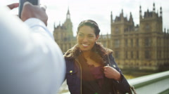 4k Happy attractive couple in London taking photo with phone  Stock Footage