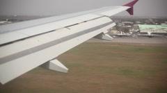 View of airplane wing during landing in Kenyatta Airport Stock Footage