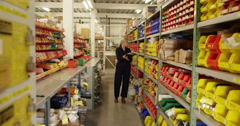 An attractive woman inspecting product in a plastics manufacturing plant - stock footage