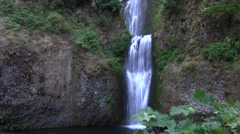 Multnomah Falls, Oregon from a distance with green trees. Stock Footage