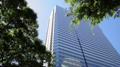 Low-angle view of Nishi-Shinjuku business district on a sunny day, Tokyo, Japan Stock Footage