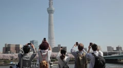 Multi-ethnic group taking pictures of Tokyo Skytree Stock Footage