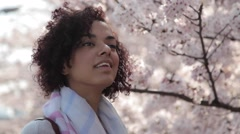 Young woman enjoying cherry blossoms in Tokyo Stock Footage