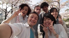Multi-ethnic group taking a selfie during hanami party in Tokyo Stock Footage