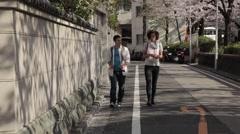 Caucasian friends walking in a residential area in Tokyo, Japan Stock Footage