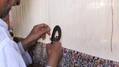 Carpet weaving. Indian man weaves a carpet Kashmir at weaving factory Stock Footage