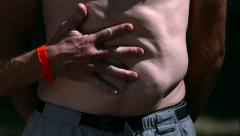 Man slapped in the stomach in slow motion Stock Footage