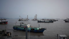 Ships back to modern fishing port Stock Footage