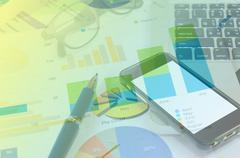 Bussines graph and pen Stock Photos