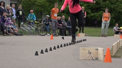 Woman roller skater ride slalom element black cones on asphalt. 4K Stock Footage