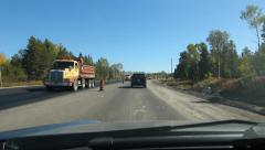 Road construction. Passing heavy equipment and paving vehicles. - stock footage