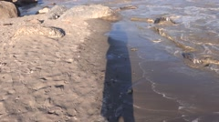 River water tries to spoil the shadow of a man Stock Footage
