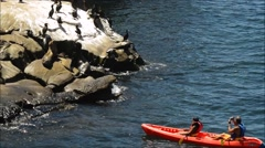 Kayakers move in close to photograph Sea lions Stock Footage