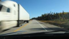 Passing two trucks on Hwy 17 in Northern Ontario. Stock Footage