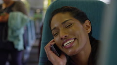 4k Beautiful woman on train journey talking on mobile phone. Stock Footage
