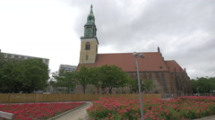 The red roof and green tower of St Mary's Church in Berlin Stock Footage