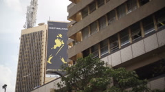 Skyscraper building with advert in Nairobi - stock footage