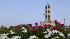 Garden with old lighthouse in Tel Aviv Port Stock Footage