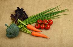 Summer artisan vegetables and greens at canvas - stock photo