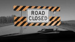 Driving up to ROAD CLOSED sign. Time lapse. Selective colour. - stock footage