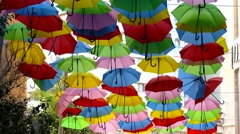 Colorful umbrellas covering a street in Jerusalem. Stock Footage
