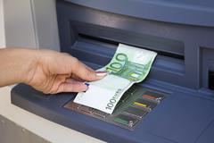 Withdrawal money out of ATM - stock photo